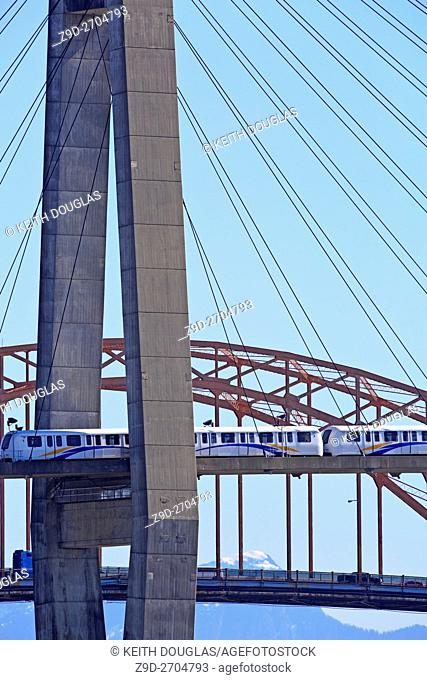 Skytrain Rapid transit bridge crossing the Fraser River from new Westminster to Surrey, British Columbia