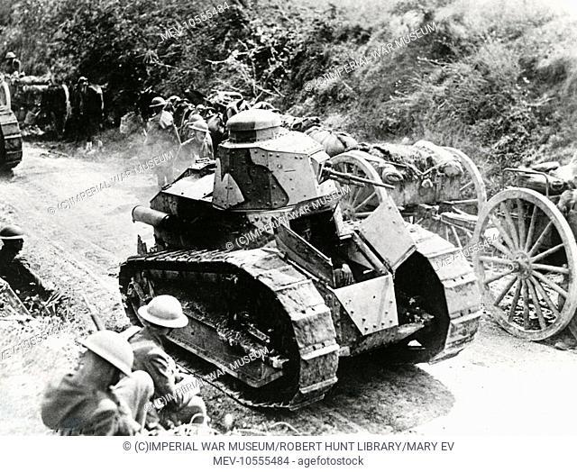 French tanks (driven by Americans) moving to the support of French troops at Valpries Farm, near Juvigny, northern France