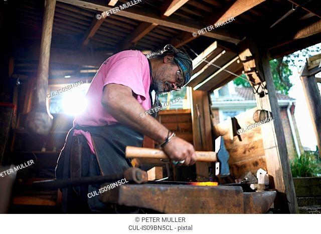 Blacksmith working in his forge