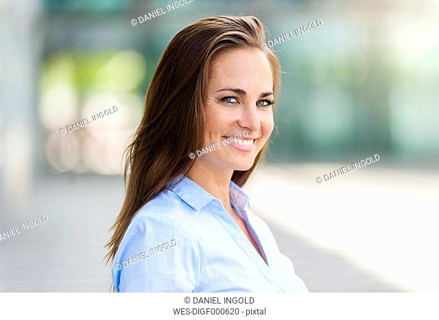 Portrait of smiling brunette woman