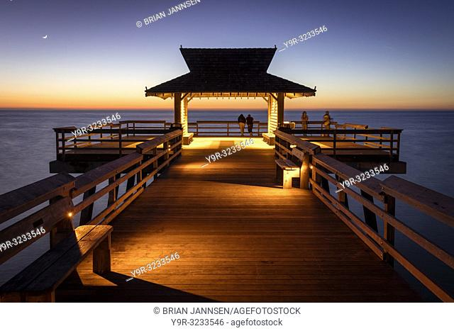 Twilight view on Naples Pier overlooking the Gulf of Mexico, Naples, Florida, USA