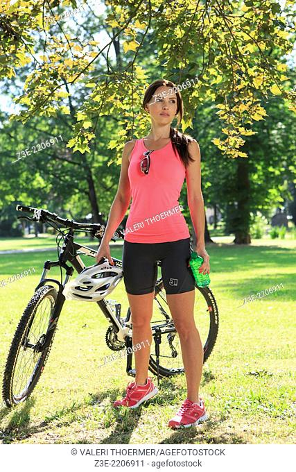 cycling woman taking a break in the park