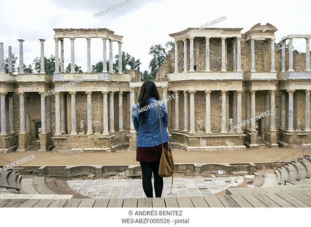 Spain, Merida, back view of woman standing in front of Roman theater