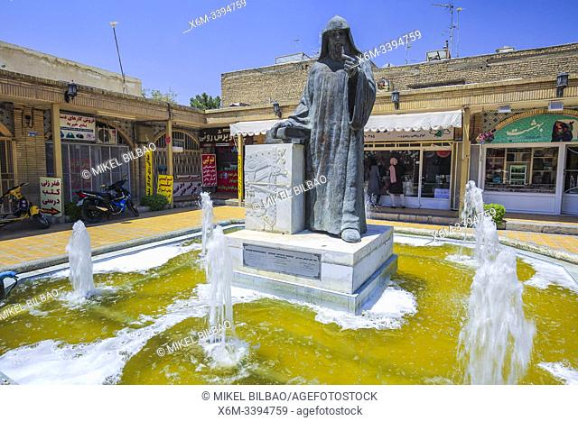Khachatur Kesaratsi archbishop in front of the Vank Cathedral or Holy Savior Cathedral. New Julfa district. Isfahan, Iran. Asia
