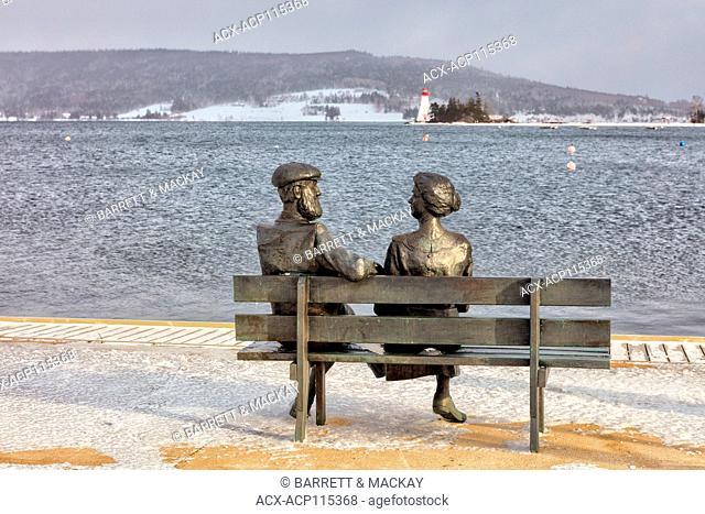 statue of Alexander Graham Bell and his wife in winter, Baddeck, Cape Breton, Nova Scotia, Canada