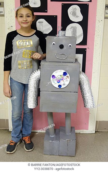 6th Grade Girl With Robot Art Project, Wellsville, New York, USA