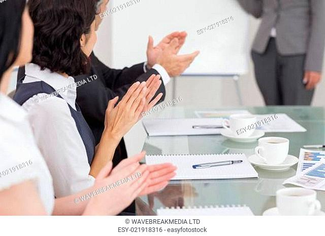 Businesspeople clapping