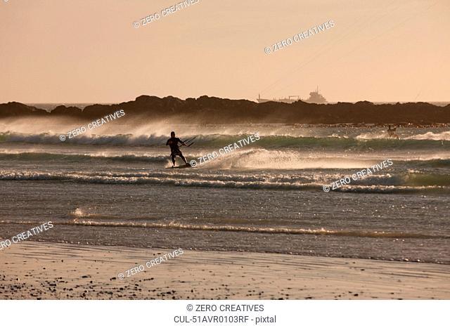Man windsurfing in waves