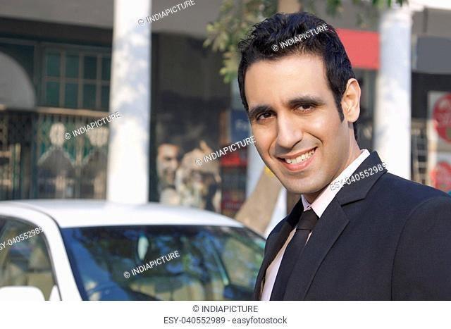 Portrait of a businessman smiling , INDIA , DELHI
