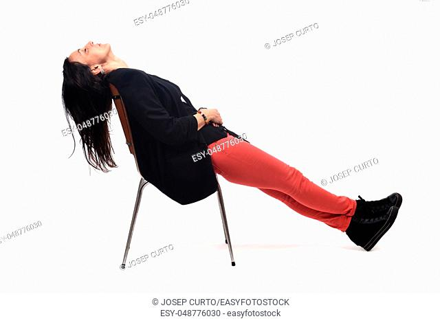 full portrait of a woman lying on a chair on white