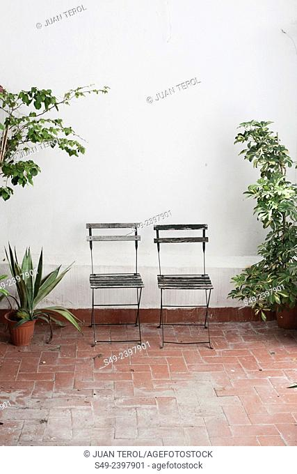 Couple chairs outdoors on a patio