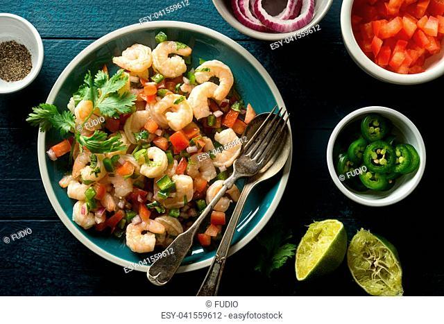 Delicious shrimp ceviche with tomato, red onion, jalapeno pepper, cilantro and lime