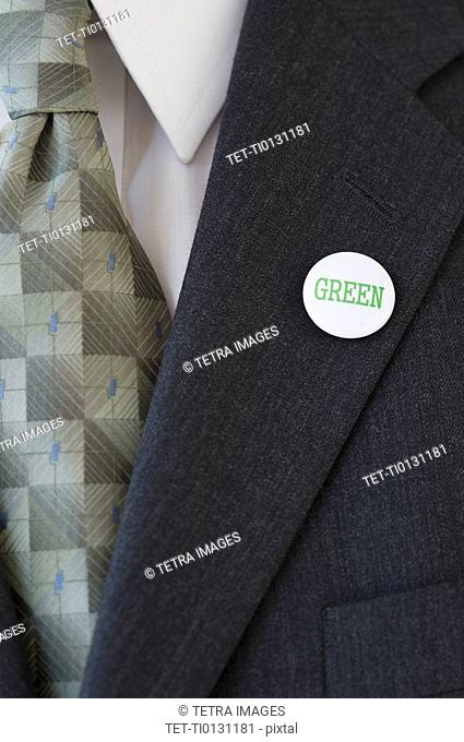 Eco-friendly button on businessman's lapel