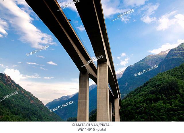 Highway bidge passing through the mountains in switzerland