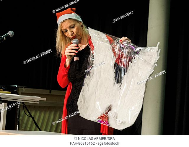 Angel wings packed in plastic are auctioned in Nuremberg,Germany, 28 December 2016. At the annual 'Markt der langen G'sichter' (lit