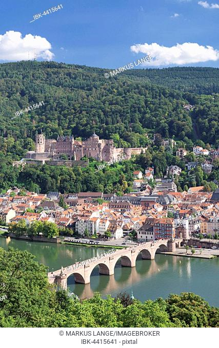 View of historic centre with Karl Theodor Bridge, gate, and castle from the Philosopher's Walk in Heidelberg, Baden-Württemberg, Germany