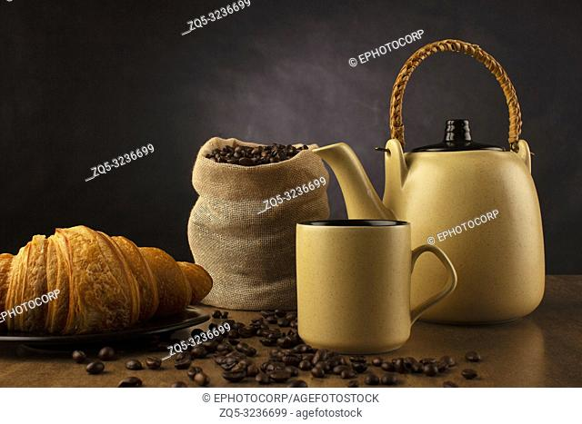 Table top with coffee tea pot, cup and coffee beans, Pune, India