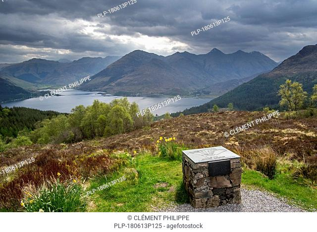 Orientation table at the Bealach Ratagain / Ratagan viewpoint with names of the mountain summits of the Five Sisters of Kintail, Highland, Scotland