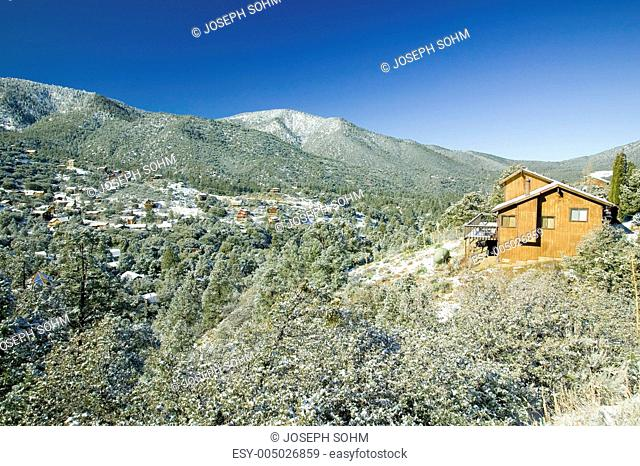 Snowy landscape with mountain cabin after winter storm in Pine Mountain Club, Kern County, Southern California