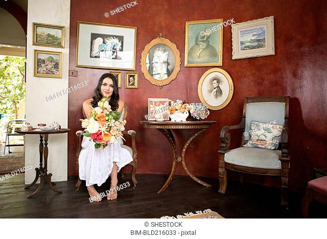 Bride holding bouquet of flowers in waiting room