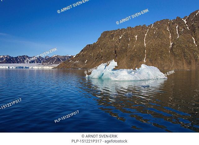 Calved iceberg from the Lilliehöökbreen glacier melting in the Lilliehöökfjorden, fjord branch of Krossfjorden in Albert I Land, Spitsbergen, Svalbard, Norway