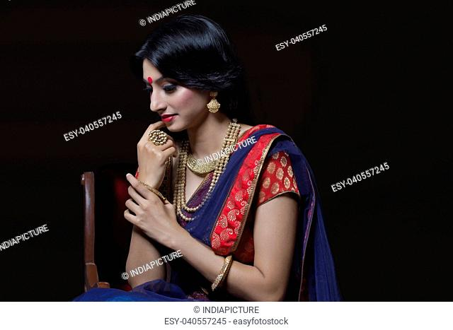 Side profile of a beautiful bride with jewelery