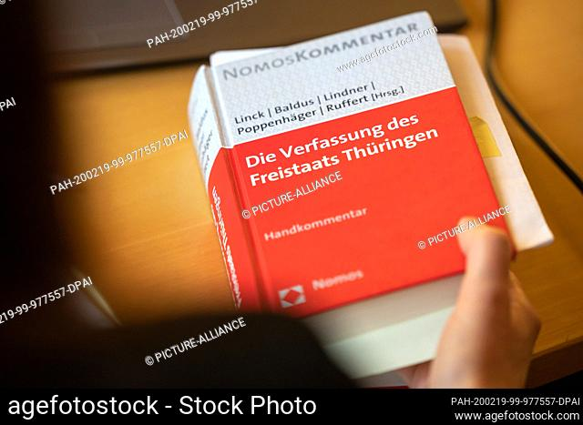 19 February 2020, Thuringia, Weimar: The constitution of the Free State of Thuringia is on a table at the Thuringian Constitutional Court