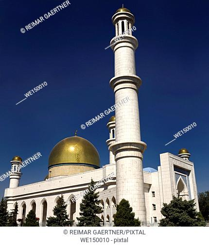 Golden dome and minaret of Central Mosque in Almaty Kazakhstan