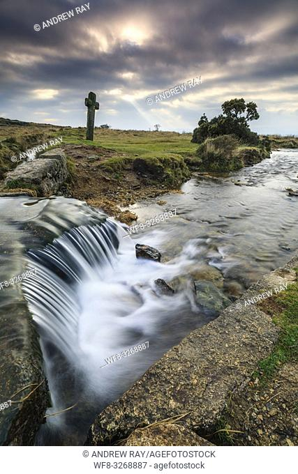 A waterfall on the Devonport Leat at Windy Post in the Dartmoor National Park. A long shutter speed was utilised to blur the movement in the water coming over...