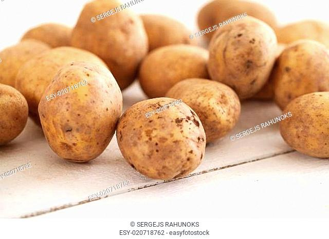 Rustic unpeeled potatoes on a table