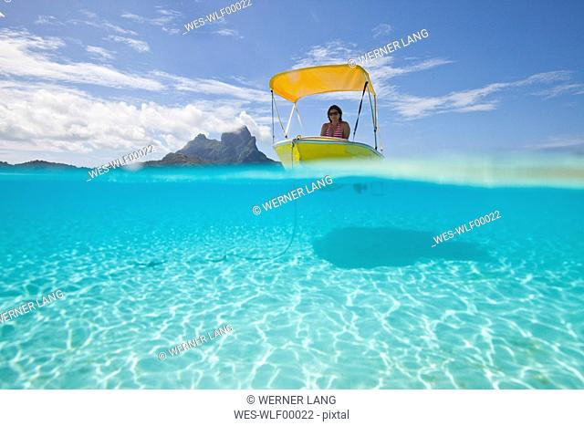 Oceania, Bora Bora, tourist in moored boat