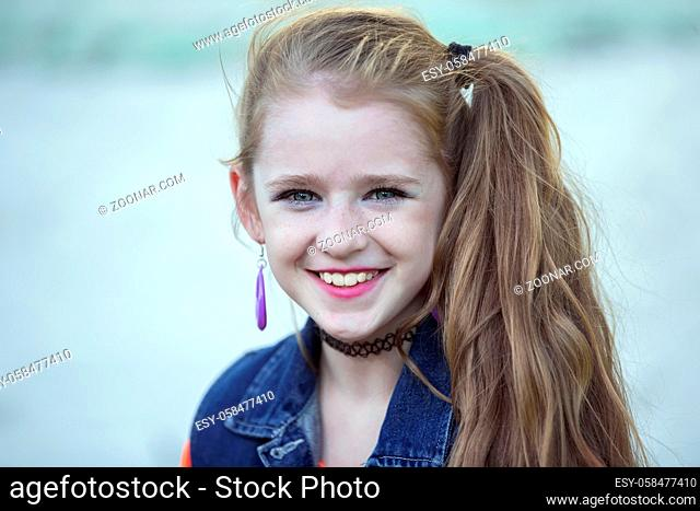 Little girl with bright makeup in retro style. Child model