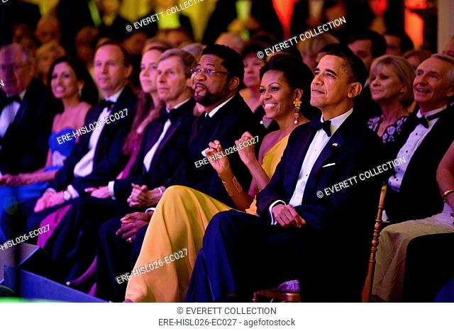 President and Michelle Obama listen as Gladys Knight performs during the Governors Dinner in the White House East Room. Feb. 27 2011