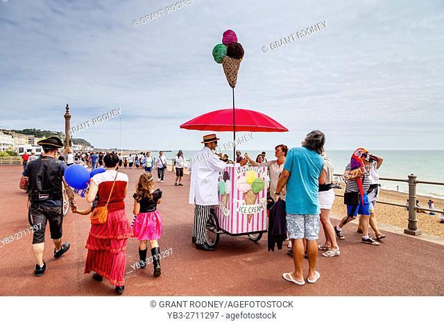 People Buying Ice Creams On Hastings Seafront, Hastings, East Sussex, UK