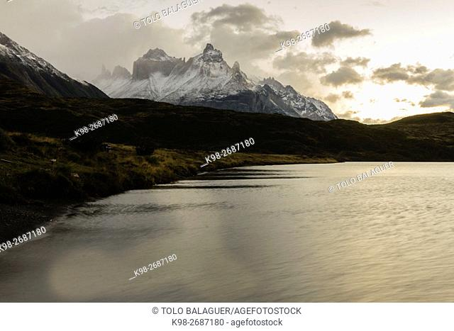 Chile, Patagonia, Cuernos del Paine (Horns) and Lake Pehoe in Torres del Paine National Park at sunset