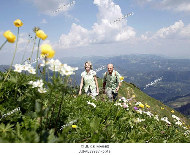 Senior couple hiking, Kleinwalsertal, Allgau, Germany