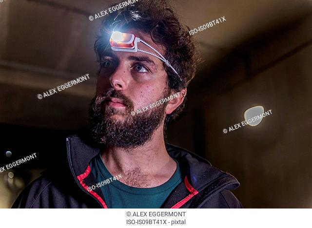 Runner with headlamp in tunnel