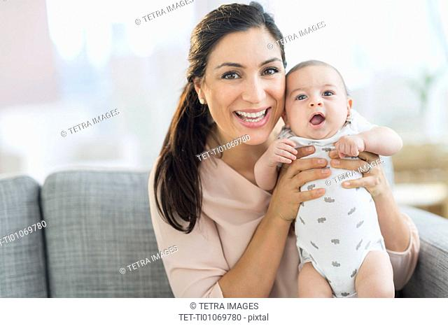 Mother holding baby boy (2-5 months)