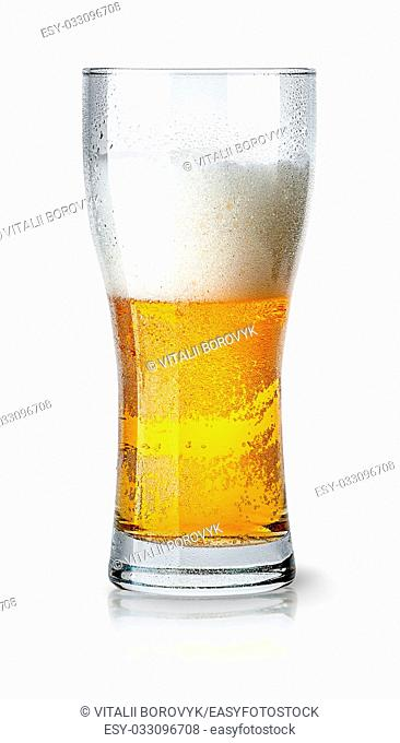 Half glass of light beer with foam isolated on white background