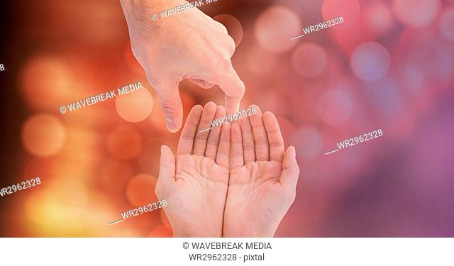 Close-up of hands over blur background
