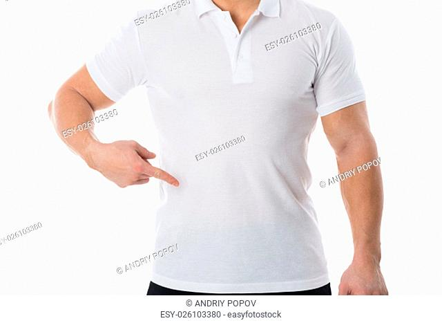Midsection of man in casuals standing against white background