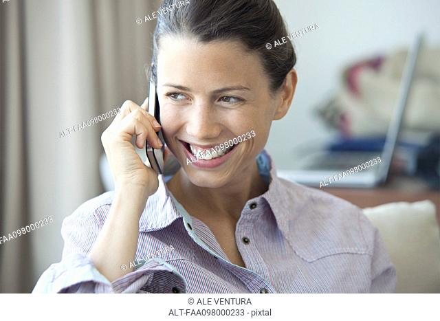 Woman enjoying cell phone conversation