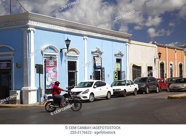 Motorcyclist in front of the colonial buildings at Plaza Juan Carbo Square in the city center, Campeche, Campeche State, Mexico, Central America