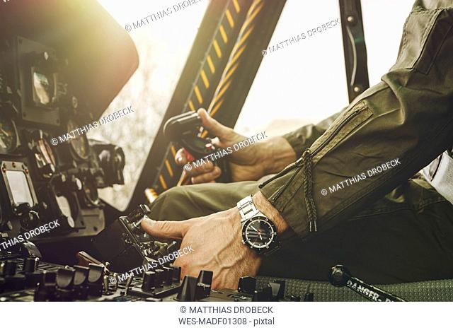 Close-up of pilot in cockpit of a helicopter