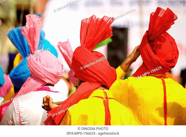 Young Sikhs boys in colourful traditional attire during the cultural events held for celebrations of 300th year of consecration of perpetual Guru Granth Sahib ;...