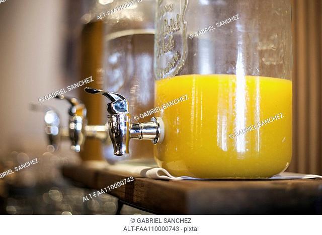 Orange juice in glass dispenser