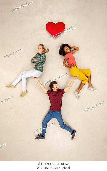 Man balancing two women on his hands, not making a decision