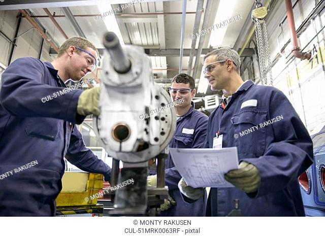 Apprentices learning in car factory