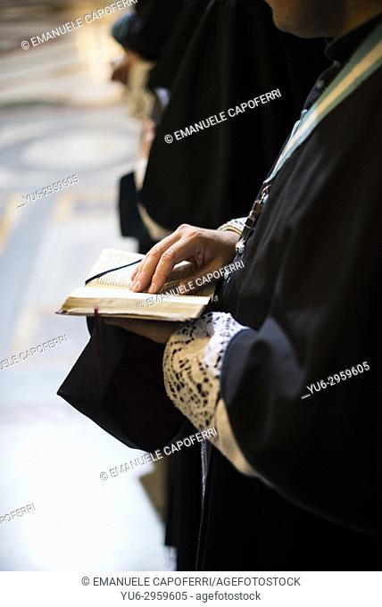 Catholic priest recites the breviary in church, Rome, Italy