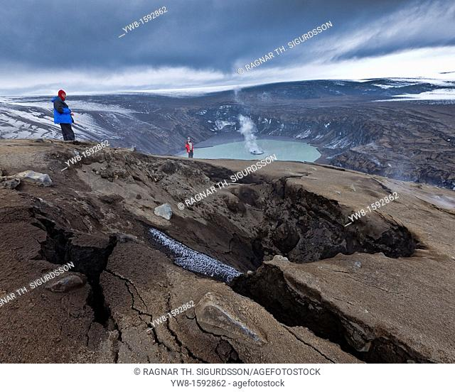 Scientist viewing steaming crater after Grimsvotn eruption, Iceland  The eruption began on May 21, 2011 spewing tons of ash